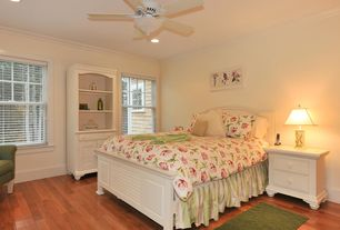Country Guest Bedroom with Standard height, Ceiling fan, can lights, Crown molding, Hardwood floors, double-hung window