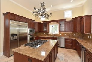 Traditional Kitchen with Glass panel, limestone tile floors, Kitchen island, Simple Granite, Crown molding, Raised panel