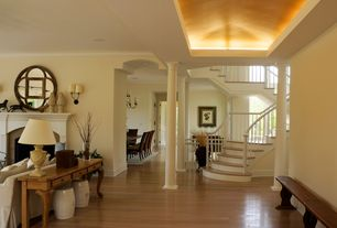 Traditional Entryway with can lights, Laminate floors, Columns, Standard height, flat door