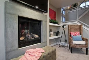 Contemporary Living Room with Built-in bookshelf, Carpet, Loft, Cement fireplace