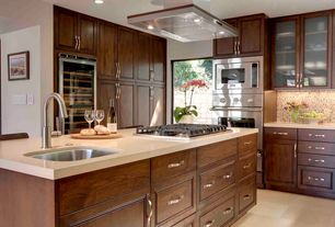 Traditional Kitchen with Ceramic Tile, Undermount sink, Raised panel, Breakfast bar, Wine refrigerator, Corian counters