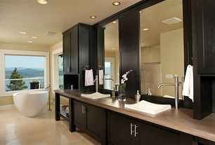 Contemporary Master Bathroom with can lights, linen and towel storage cabinet, Flush, picture window, Freestanding, Shower