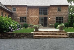 Country Front Door with Pathway, French doors, exterior stone floors, Raised beds, Barn door