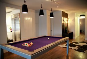 Modern Game Room with Wall sconce, Pendant light, flush light, Built-in bookshelf, Hardwood floors