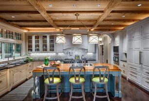 Country Kitchen with Box beam ceiling, U-shaped, Custom cabinetry, Breakfast bar, Angled wood flooring, Kitchen island