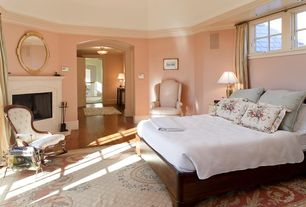 Traditional Master Bedroom with Crown molding, Hardwood floors, stone fireplace