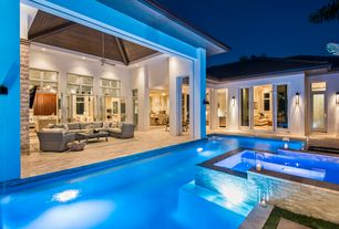 Contemporary Swimming Pool with exterior stone floors, exterior tile floors, Pool with hot tub