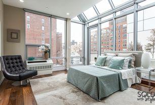 Contemporary Master Bedroom with Casement, Urban city view, Hardwood floors, picture window, Bedding, Paint, Solarium windows
