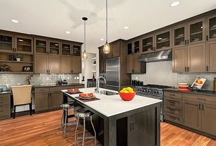 Transitional Kitchen with Kitchen island, Undermount sink, Corian counters, Glass panel, L-shaped, Flush, European Cabinets
