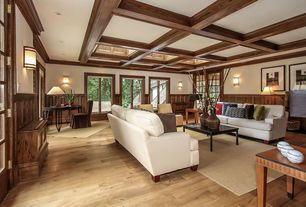 Traditional Living Room with Crown molding, Hardwood floors, Exposed beam, Wainscotting, Wall sconce, High ceiling, Casement