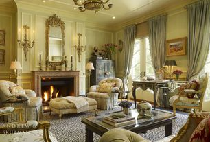 Traditional Living Room with stone fireplace, Wainscotting, Chandelier, French doors, Crown molding, Wall sconce
