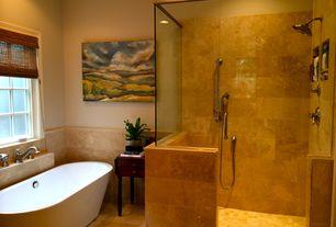 Contemporary Full Bathroom with Standard height, can lights, Bathtub, limestone tile floors, Paint, frameless showerdoor