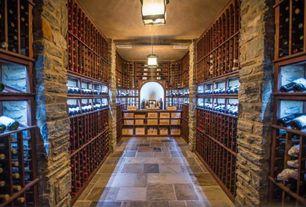 Traditional Wine Cellar with travertine floors, Exposed beam, Pendant light, Built-in bookshelf