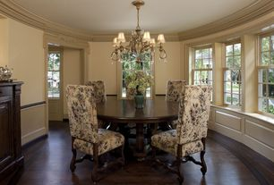 Traditional Dining Room with Chandelier, Standard height, Chair rail, Crown molding, double-hung window, Laminate floors