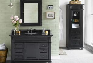 "Traditional Master Bathroom with Pendant light, Raised panel, Soapstone, Design element 22"" x 65"" linen cabinet, Glass panel"