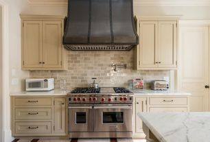 Traditional Kitchen with Ms international - calacatta classic marble, Complex marble counters, Wolf wgr486c gas range