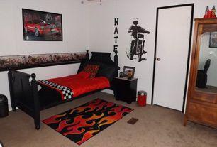 Eclectic Kids Bedroom with Paint, Twin bed, Carpet, Flame area rug, flat door, Mural, Ceiling fan, Crown molding