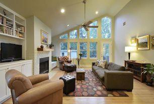 Traditional Living Room with Hardwood floors, French doors, Built-in bookshelf, Ceiling fan