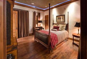 Country Guest Bedroom with Hardwood floors, Crown molding, Built-in bookshelf, Louvered door