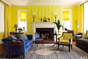 Eclectic Living Room with Paint 1, Chair rail, Paint 2, Cement fireplace, Viceroy Chair, Maria Tufted Velvet Sofa, Blue