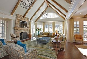 Traditional Great Room with Cassiopeia orb chandelier, Stacked stone fireplace, Cathedral ceiling, Throw pillow, Wainscotting