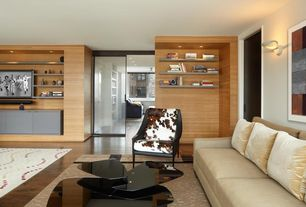 Contemporary Living Room with Hardwood floors, Built-in bookshelf, Wall sconce