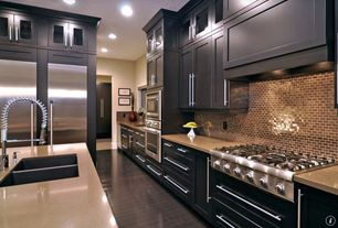 Contemporary Kitchen with Limestone counters, full backsplash, Glass panel, Multiple Sinks, Built In Refrigerator, Flush