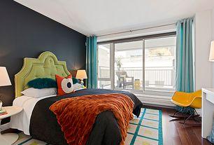 Contemporary Guest Bedroom with Window seat, Built-in bookshelf, French doors, Hardwood floors