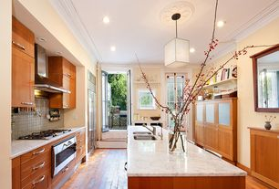 Contemporary Kitchen with Hardwood floors, French doors, Complex marble counters, Breakfast bar, Kitchen island, Flush