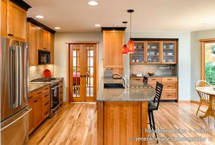 Craftsman Kitchen with Limestone Tile, L-shaped, Red glass pendant light, Glass display cabinet, Contrasting crown molding