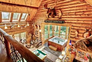 Rustic Game Room with Cathedral ceiling, Skylight, Hardwood floors, Pendant light, Loft