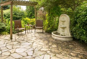 Traditional Landscape/Yard with exterior stone floors, Fountain, Trellis