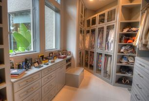 Traditional Closet with can lights, Casement, Standard height, Built-in bookshelf, picture window, sandstone tile floors