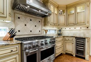 Country Kitchen with Ge monogram gas professional range, Wine refrigerator, Stone Tile, L-shaped, Limestone Tile