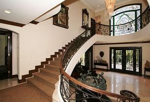 Art Deco Entryway with French doors, simple marble tile floors, Balcony