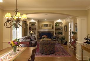 Country Living Room with can lights, stone fireplace, Standard height, Chandelier, Built-in bookshelf, Hardwood floors