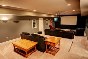 Country Home Theater with specialty door, Wall sconce, Exposed beam, Carpet