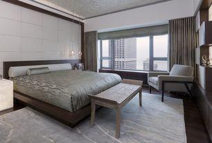Modern Master Bedroom with Crown molding, Standard height, picture window, Hardwood floors, Pendant light, Built-in bookshelf