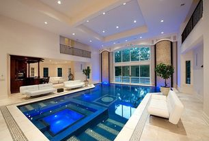 Contemporary Swimming Pool with exterior concrete tile floors, Indoor pool, exterior tile floors, French doors