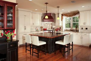 Traditional Kitchen with can lights, Wood counters, Undermount sink, Pendant light, Standard height, Complex granite counters