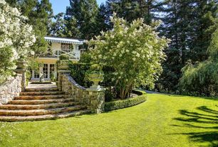 Traditional Landscape/Yard with exterior stone floors, Deck Railing, French doors, Pathway, Casement, Raised beds
