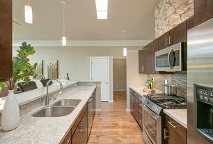 Contemporary Kitchen with Pendant light, Simple granite counters, European Cabinets, Ceramic Tile, Skylight, Breakfast bar