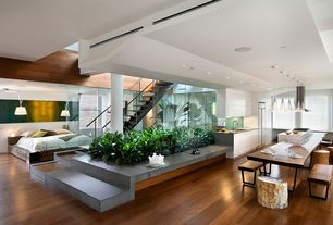 Contemporary Great Room with Hardwood floors, can lights, Standard height, Pendant light, Columns, double-hung window