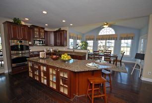 Traditional Kitchen with L-shaped, Inset cabinets, Casement, double wall oven, built-in microwave, electric cooktop