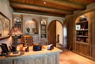 Country Home Office with terracotta tile floors, French doors, Exposed beam, Built-in bookshelf