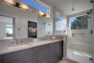 Contemporary Master Bathroom with Limestone counters, Undermount sink, stone tile floors, Standard height, Flush, can lights