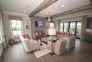 Contemporary Living Room with Built-in bookshelf, Exposed beam, flush light, French doors, Hardwood floors, Cement fireplace