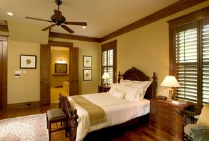 Traditional Master Bedroom with Hardwood floors, Crown molding, Ceiling fan, Built-in bookshelf