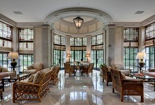 Traditional Living Room with picture window, simple marble tile floors, High ceiling, French doors, Crown molding