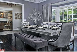 Contemporary Dining Room with Crown molding, Standard height, Hardwood floors, Paint 1, Bay window